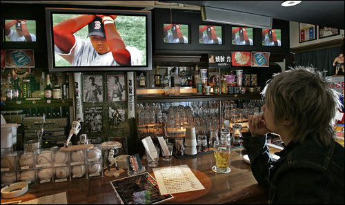 Around 3 a.m. in Japan, baseball fan Satoshi Ishimaru watched Dice-K on the big screen.