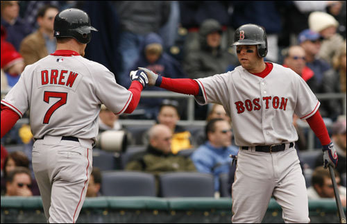 J.D. Drew (left) was congratulated by Dustin Pedroia after Drew scored on a Coco Crisp single in the eighth inning.