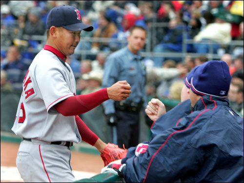 Daisuke Matsuzaka was congratulated by teammates as he made his way to the Red Sox dugout after seven innings.