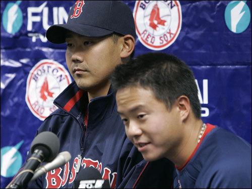 Daisuke Matsuzaka (left) and interpreter Masafumi Hoshino met the media after Boston's 4-1 win.