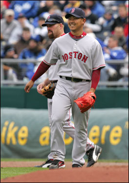 Daisuke and Kevin Youkilis shared a light moment after a force play.