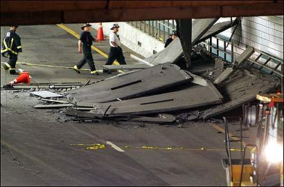 Firefighters inspected a section of the ceiling of the Interstate 90 eastbound connector after it collapsed on July 10, 2006. Numerous lawsuits have been filed in the aftermath of the tragedy.