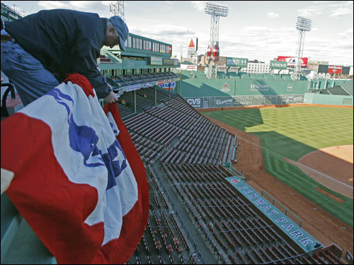 David Batchelder, of Alden Flag in Rhode Island, was working all day Monday putting up the Opening Day bunting around Fenway Park.