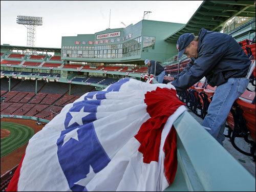 Peter Batchelder put up bunting all around Fenway on Monday.