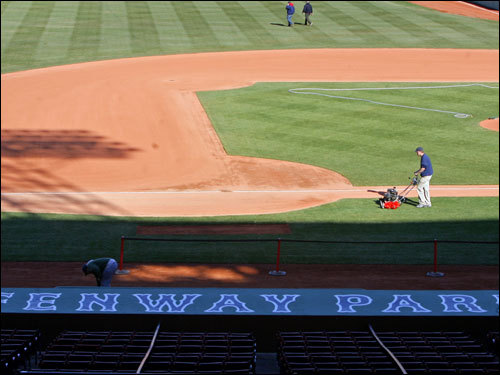 Workers prepared the field on Monday afternoon so that Fenway Park would look good for Tuesday's game.