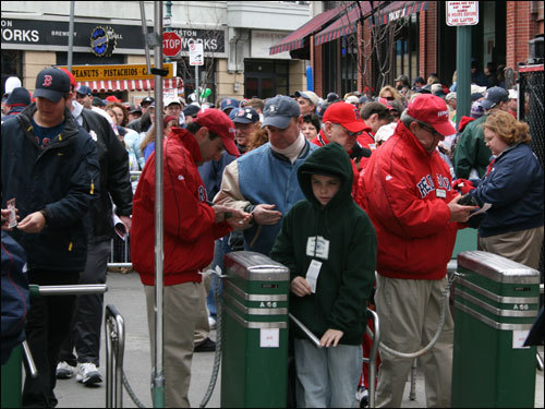The first fans make their way through the games on Yawkey Way shortly after noon.