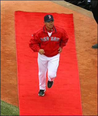 Dice-K got the red carpet treatment as he ran onto the field during his pregame intro on Opening Day at Fenway.