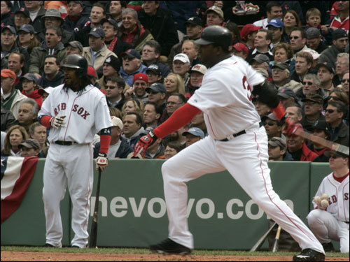 Manny Ramirez, left, watched David Ortiz's first at bat in the the first inning.