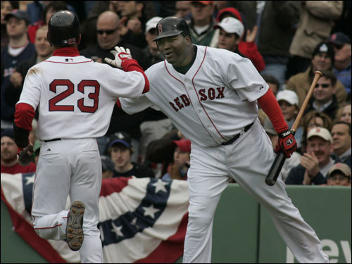 David Ortiz congratulated Julio Lugo after he scored during the second inning.