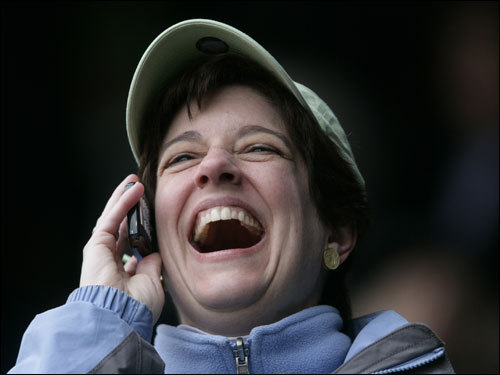 Red Sox Katelyn Quynn phones home with good news as the Red Sox led big early on.