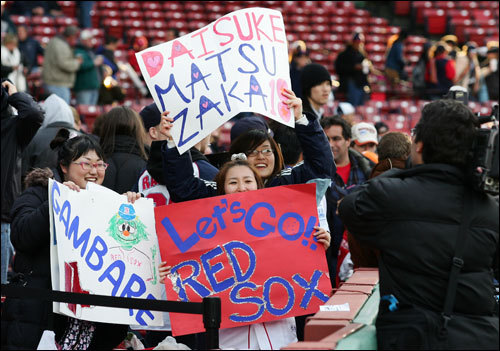 Fans showed their Dice-K support in front of a Japanese television camera before the game.