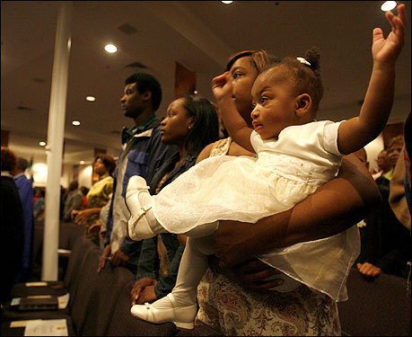 Nyerah Thomas held her daughter, Shmika Jackson, during a Good Friday service at the Jubilee Christian Church in Boston.