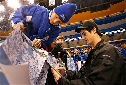 Brian Boyle, a Boston College forward and team captain for the hockey team, signed autographs in St. Louis on April 6 for fan Tyler Hart, 12, of Woodbury, Minn., prior to taking the ice for practice. The Eagles lost the NCAA Frozen Four championship game the next night to the Michigan State Spartans 3-1 for their second final-round loss in as many years.