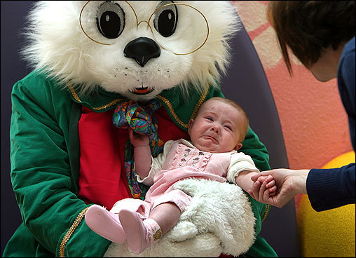 Hundreds of children had their photos taken with the Easter Bunny Saturday at the Hanover Mall. Four-month-old Alivia Kiley of Abington received some encouragement from her mother, Shannon.