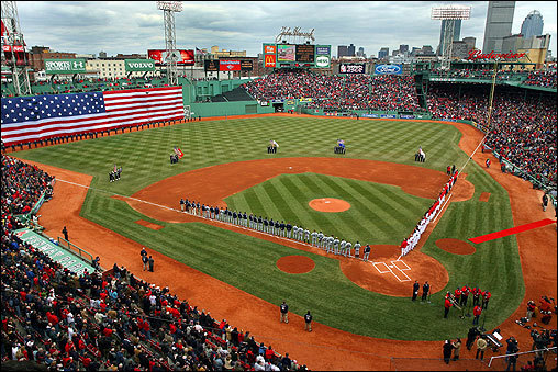 Members of the Red Sox and the Seattle Mariners stood for a moment of silence during Tuesday's Opening Day ceremonies at Fenway Park. Free agent acquisition J.D. Drew homered in his first home game with the Red Sox as they beat the Mariners 14-3.