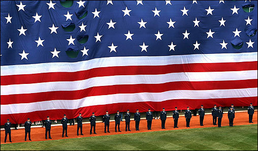 An American flag was unfurled over the Green Monster during the Opening Day ceremonies.