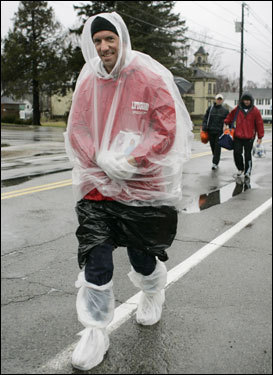 Brett Courter of Bradenton, Fla., was wearing plastic bags to keep dry as he walked to the waiting area.