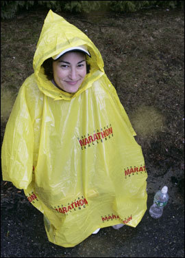 Rebecca Hagopian of Shrewbury wore a plastic bag to stay dry before the race.