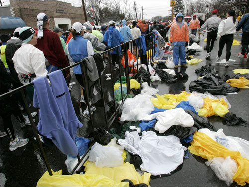 Ponchos and other clothing were discarded near the starting line in Hopkinton.