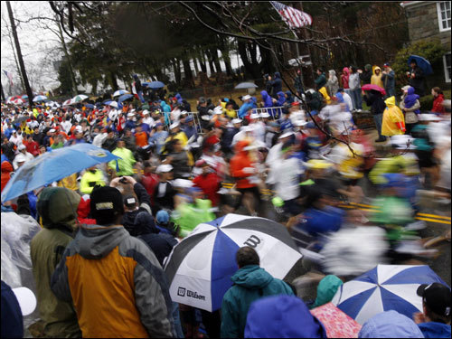 Fans watched the blur of runners as the marathon began.