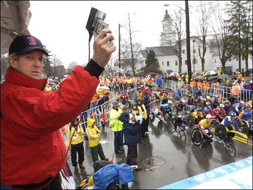 Senator John F. Kerry prepared to fire the start gun for the wheelchair race.