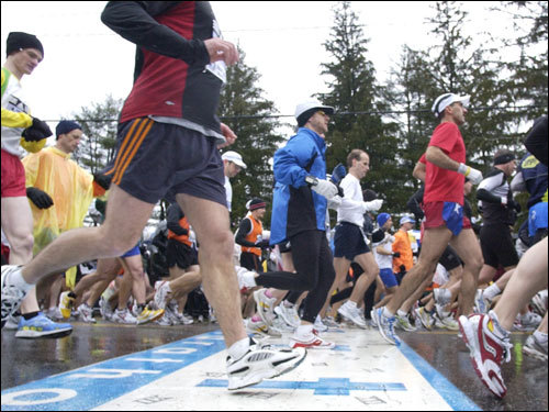 Runners crossed the starting line during the marathon.