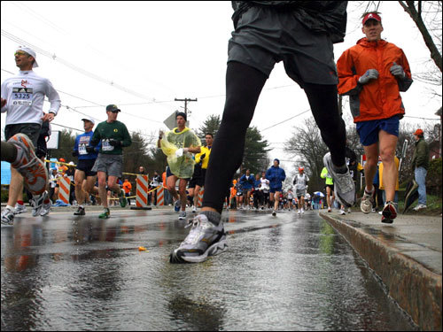 Runners avoided one of the many puddles on the course in Ashland.
