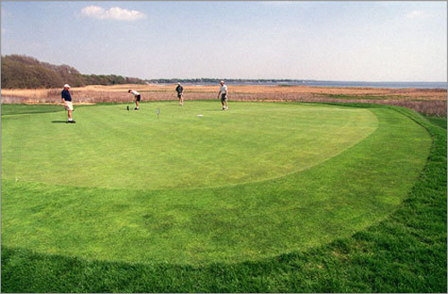 Players putting on the 17th green at the Rhode Island Country Club.