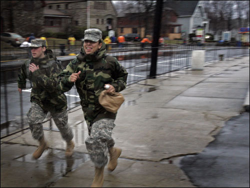Members of the National Guard run up Main Street in Hopkinton -- but not as part of the marathon. They were trying to catch up with other National Guardsmen who were providing security at the starting line.