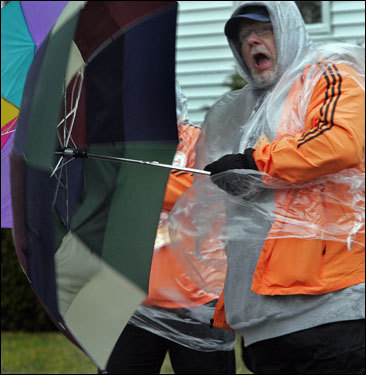 Ed Mills, a volunteer from Hopkinton, said, ' I feel like Mary Poppins' when the wind kept blowing his umbrella inside out and about.