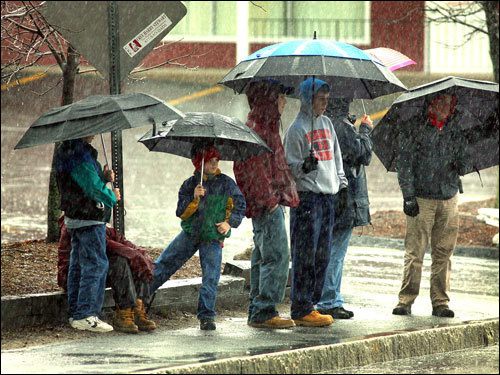 A group of spectators braved the rain near Union Street in Ashland.