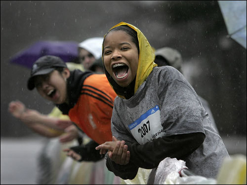 Wellesley College student Makkah Ali cheered on the runners near the campus.