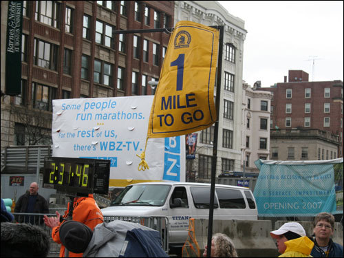 One mile to go: An encouraging sight to tired marathoners.