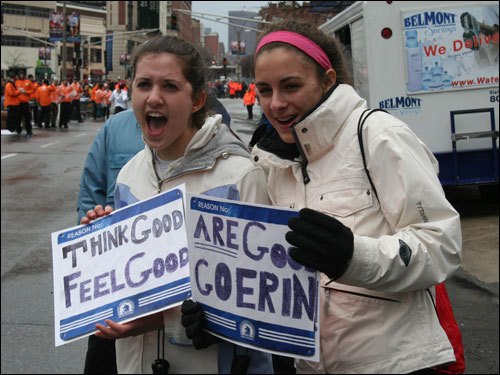 Boston University students Katie Davidoff (left) and Sammi DeMar cheered on the first runners coming through Kenmore Square. Davidoff said she was out to support her friend, Erin Carbonneau, who ran in today's marathon.
