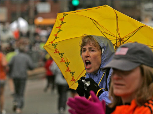 Barb Wheelock of Ames, Iowa, cheered runners making their way through Cleveland Circle.