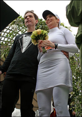 Aaron Russell and Pattiann McAdams, of New York, take time out from running the Boston Marathon to exchange wedding vows at the top of Heartbreak Hill.