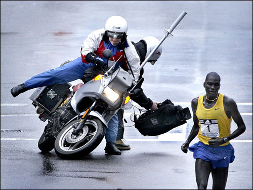Winner of the men's race Robert Cheruiyot closing in on the finish line as the TV live pool camera crew took a spill.