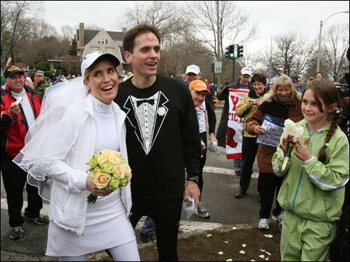 Pattiann McAdams and Aaron Russell took a break from the marathon to get married at the top of Heartbreak Hill. After the ceremony, the New York City residents continued the race.