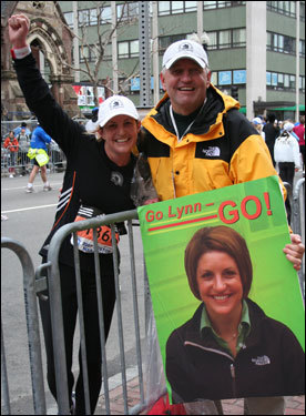 Lynn Sokolnicki, 25, from Cincinnati, Ohio, finishes her first Boston Marathon. Her father, Don, met her at the finish line.