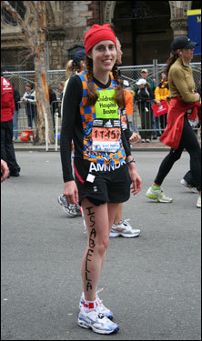 Amanda Watters finishes the Boston Marathon on her 27th birthday. Writing someone's name on your skin in black magic marker seemed to be a popular idea for some runners...