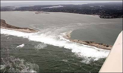 The ocean cut an opening through Chatham's Nauset Beach peninsula this week that grew to about 150 yards by yesterday.