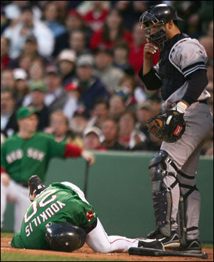 Yankees catcher Jorge Posada (right) looked on as Kevin Youkilis lay on the ground after being hit by a pitch in the second inning.