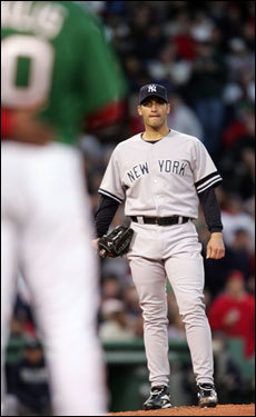 Andy Pettitte looked over at first base where Kevin Youkilis stood after being hit in the hand.