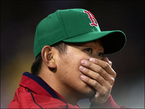 Dice-K looked on from the dugout early in the game. Daisuke Matsuzaka will start the third game of the series on Sunday.