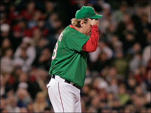 Curt Schilling walked to the mound after after the sacrifice bunt put men on second and third.