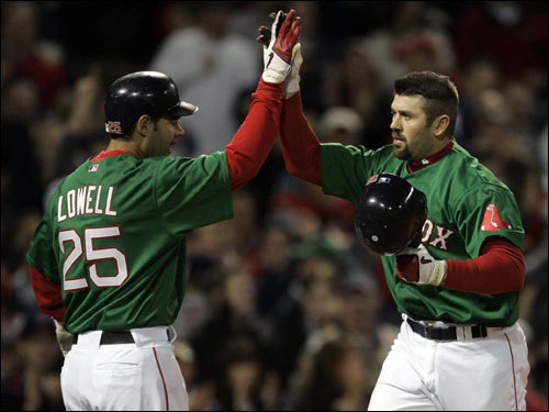 Red Sox captain Jason Varitek (right) was congratulated by Mike Lowell (left) after Varitek's fourth-inning home run tied the game at two.