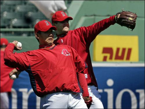 Red Sox pitchers Daisuke Matsuzaka (left) and Jonathan Papelbon threw during warm-ups.
