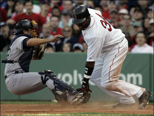 David Ortiz (right) was tagged out at the plate by backup Yankees catcher Wil Nieves (right) in the first inning.