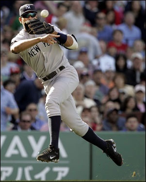 Alex Rodriguez threw to first but was too late to throw out Alex Cora (not pictured) on a bunt in the second inning.
