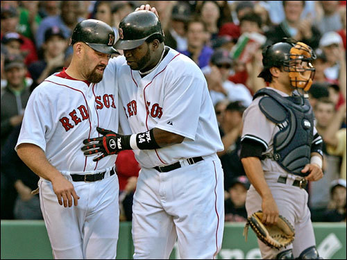 Kevin Youkilis (left) and David Ortiz (right) celebrated at the plate after Ortiz's home run.